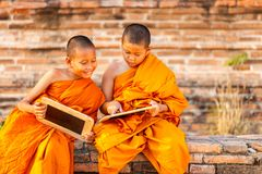 Two novice reading and studying blackboard with funny in old temple, Ayutthaya Province royalty free stock photo