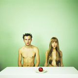 Two nude lovers with apple Royalty Free Stock Images