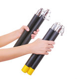 Two nunchucks in hands isolated on white Stock Photo