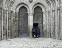 Two nuns looking into a church Stock Photo