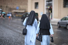 Two nuns. In St. Peter`s Square in the Vatican. Rome, Italy royalty free stock photography
