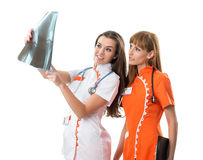 Two nurse  watching X Ray image Stock Photo
