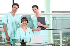 Two nurses. Standing and a nurse using a headset Stock Photo