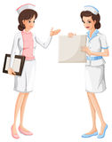 Two nurses in blue and pink uniform Royalty Free Stock Photo
