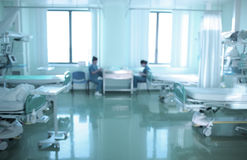 Two nurses are on duty in ICU, defocused background Royalty Free Stock Images