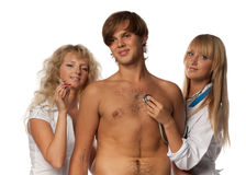 Two nurses and the patient stock images