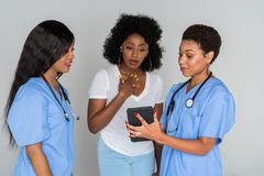 Two Nurses With Patient Royalty Free Stock Photography