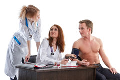 Two nurses and the patient Stock Photo