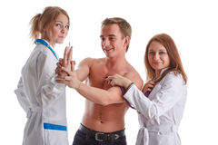 Two nurses and the patient Royalty Free Stock Image