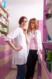 Two nurses at the pharmacy desk Royalty Free Stock Photo