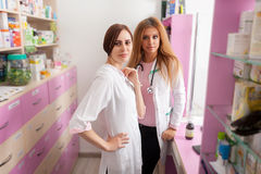 Two nurses at the pharmacy desk Royalty Free Stock Photography