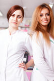 Two nurses in pharmacy smiling at camera Stock Photo
