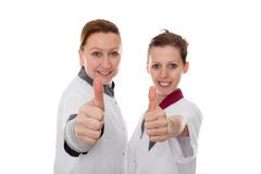 Two  nurses showing positive energy Royalty Free Stock Photography