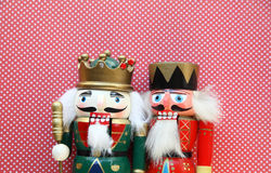 Two nutcrackers on polka dots Stock Photos