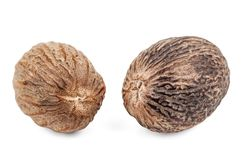 Two nutmeg on white Stock Images