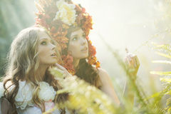 Two nymph sisters in the jungle Royalty Free Stock Photos