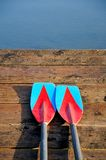Two oars. On wooden and lake Royalty Free Stock Photography