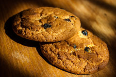 Two oatmeal cookies on wood Stock Photography