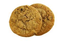 Two oatmeal raisin cookies royalty free stock photos
