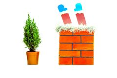 On a white isolated background red brick pipe and a small live Christmas tree stock images