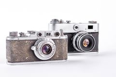 Two obsolete film cameras. Old vintage photo cameras isolated on white background Royalty Free Stock Photography