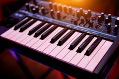 Two octaves electronic musical keyboard synthesizer close-up stock photos