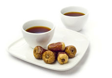 Two offee cups and dates. Royalty Free Stock Image