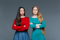 Two offended girlfriend looking at each other Royalty Free Stock Photos