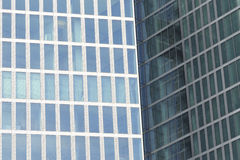 Two office buildings - detail. Modern architecture of two office buildings - the angle of view makes one out of two Royalty Free Stock Photography