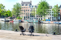 Two office chairs opposite the buildings Royalty Free Stock Photo