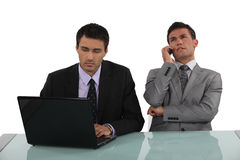 Two office colleagues Stock Photography