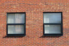 Office windows in brick building Stock Image
