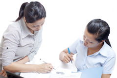 Two office women looking on chart Stock Photos
