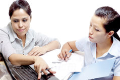 Two office women looking on chart Royalty Free Stock Photo
