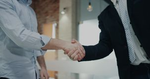 Two office worker closeup holding hands. 4k. Two office worker closeup holding hands stock footage