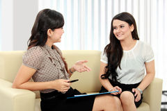 Two office worker discuss Stock Images