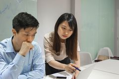 Two office worker discuss about problem Stock Photo
