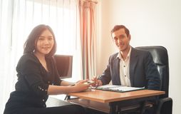 Two office worker male and female facing camera, Business team. Concept Stock Image