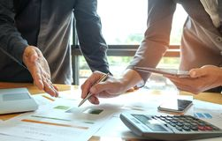 Free Two Office Workers Are Analyzing Data,Business Concepts. Royalty Free Stock Photo - 113070705