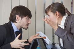 Two office workers in conflict Royalty Free Stock Images
