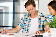 Two office workers at the desk Royalty Free Stock Photos