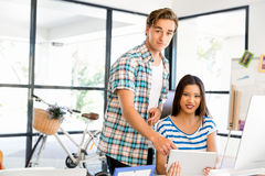 Two office workers at the desk Stock Photos