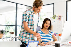 Two office workers at the desk Royalty Free Stock Images