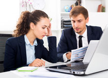Two office workers made a mistake Stock Photos