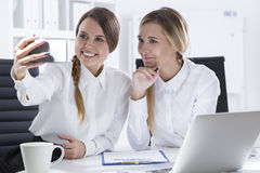 Two office workers taking a selfie Royalty Free Stock Photos