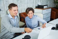 Two office workers team job lap top cooperation students Royalty Free Stock Photos
