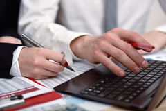 Two office workers working together Royalty Free Stock Image