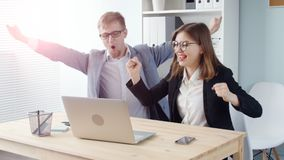 Two office workers. Young business people rejoice after a successful transaction. Young man and woman stock footage