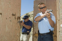 Two Officers Aiming Hand Guns At Firing Range Royalty Free Stock Photo