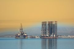 Two offshore rigs in Caspian stock images